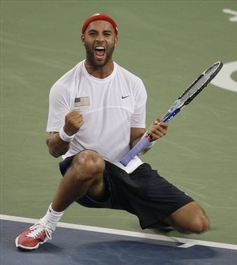 Teams USA's James Blake after defeating Roger Federer