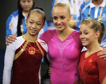 Nastia Liukin (C), Shawn Johnson (R), Team USA & China's Yilin Yang (L)