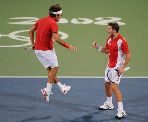 Roger Feder Flies towards Doubles partner Stanislas Wawrinka