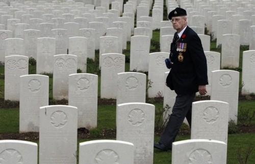 Canadian World War II veteran John Henderson, of Carnduff, Saskatchewan, tours the Vis-en-Artois British Cemetery in Vis-en-Artois, France late Monday