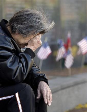 Vietnam War veteran Luke Kircher reacts as he reflects at the Vietnam Veterans Memorial on Veterans Day in Philadelphia